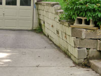 a failing retaining wall around a driveway in Buffalo