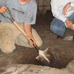 Digging a hole for the engineered fill used in a crawl space support system installation in Orchard Park