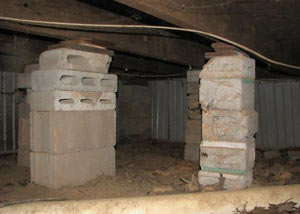crawl space repairs done with concrete cinder blocks and wood shims in a Elma home