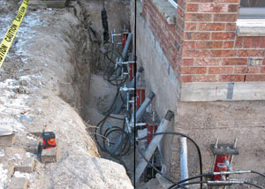 Foundation piers installed around a house with a foundation settlement issues in Arcade