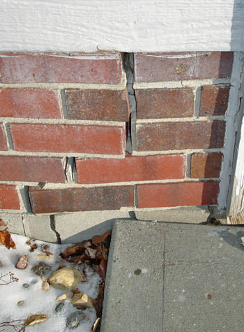 garage walls cracking due to street creep