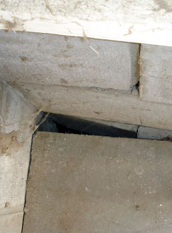 inward rotation of a foundation wall damaged by street creep in a garage in Collins