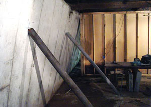 A severely tilting foundation wall propped up by steel beams in Cheektowaga, West Seneca, Dunkirk.