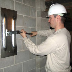installing a wall anchor to repair an bowing foundation wall in East Aurora