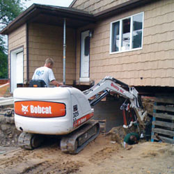 Excavating to expose the foundation walls and footings for a replacement job in East Amherst