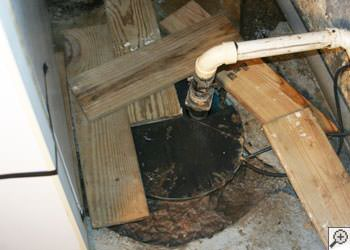 An ugly, clogged sump pump system in Orchard Park, Western New York