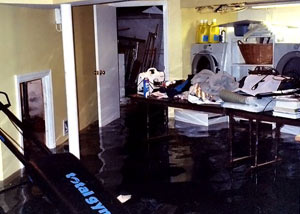 A laundry room flood in Angola, with several feet of water flooded in.