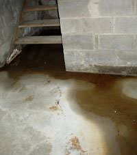Flooding floor cracks by a hatchway door in Cheektowaga, West Seneca, Dunkirk