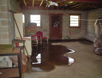a flooded basement floor in a Gowanda home