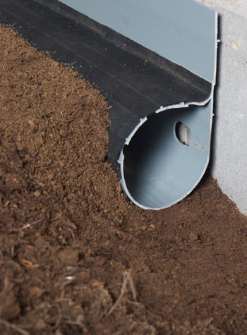 weeping tile system for dirt crawl space floors with groundwater