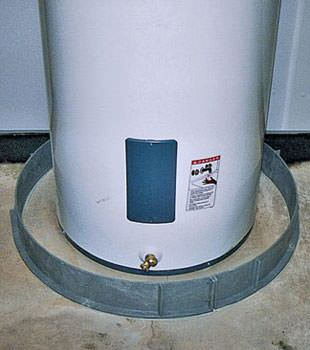 An old water heater in Derby, NY with flood protection installed